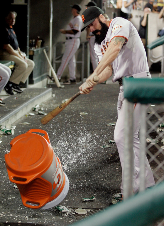 . San Francisco Giants reliever Brian Wilson takes a bat to a water cooler after being pulled from a interleague baseball game against the Detroit Tigers in the ninth inning Friday, July 1, 2011 in Detroit. Wilson was pulled after giving up a RBI-single to Detroit\'s Brandon Inge. The Giants defeated the Tigers 4-3. (AP Photo/Duane Burleson)