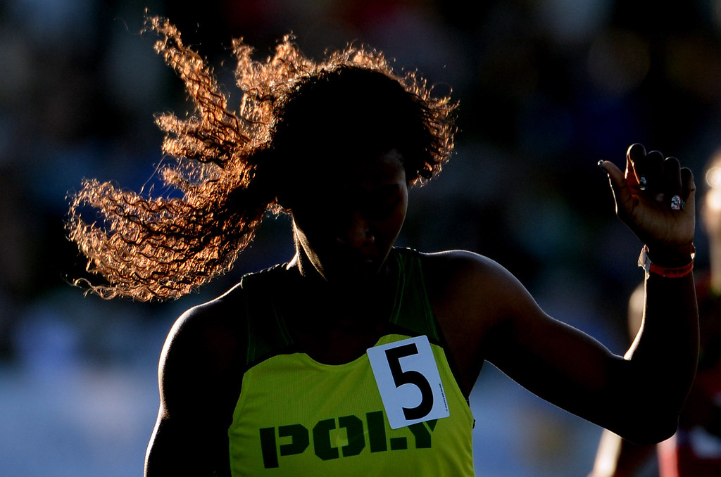 . Long Beach Poly\'s Kaelin Roberts, center, wins the 400 meter dash during the CIF California State Track & Field Championships at Veteran\'s Memorial Stadium on the campus of Buchanan High School in Clovis, Calif., on Saturday, June 7, 2014. 