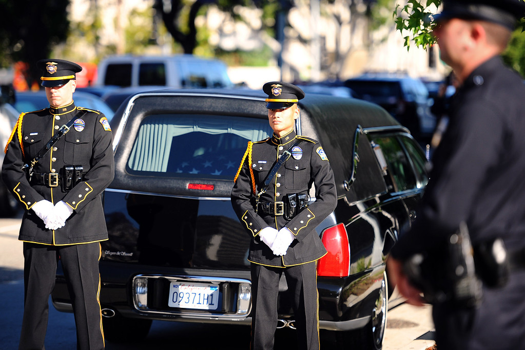 . A hearse containing the casket of LAPD Officer Roberto Sanchez is parked outside the Cathedral of Our Lady of the Angels in Los Angeles, CA May 14, 2014.  Sanchez was killed in a hit-and-run crash involving a SUV driver who is accused of deliberately ramming the officer\'s patrol car in Harbor City.(Andy Holzman/LA Daily News)