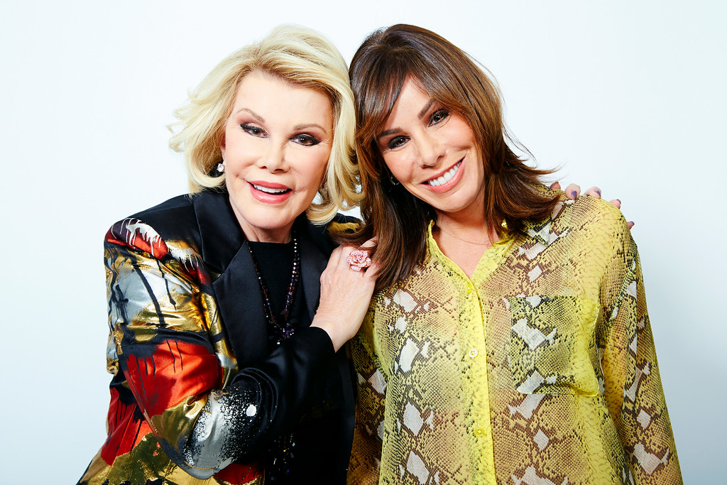 ". This Feb. 21, 2013 photo shows comedian Joan Rivers, left, and her daughter Melissa Rivers in New York. Joan leads a panel on ""Fashion Police,\"" with Giuliana Rancic, Kelly Osbourne and stylist George Kotsiopoulos as they critique celebrity style choices. Melissa is a co-executive producer and occasional panelist as well. (Photo by Dan Hallman/Invision/AP)"