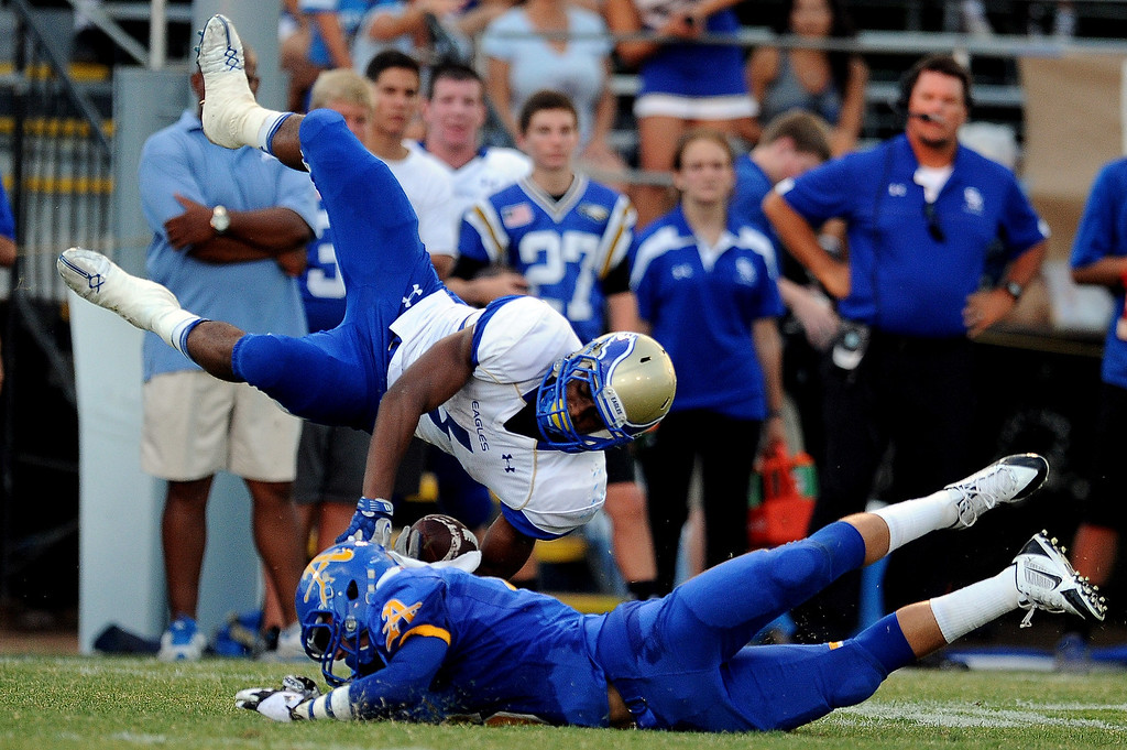 . Bishop Amat\'s Joey Chavez upends Santa Margarita\'s Jeremy McNichols (6) in the first half of a prep football game at Bishop Amat High School on Friday, Aug. 30, 2013 in La Puente, Calif.   (Keith Birmingham/Pasadena Star-News)