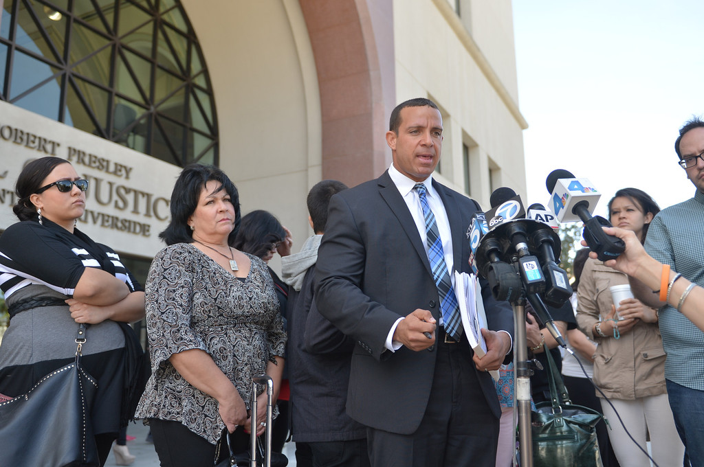 . Attorney Randy Collins, who is representing Andrea Michelle Cardosa in court, speaks to the media outside the Riverside Superior Court house Friday March 7, 2014 in Riverside. Photo by LaFonzo Carter/The Sun