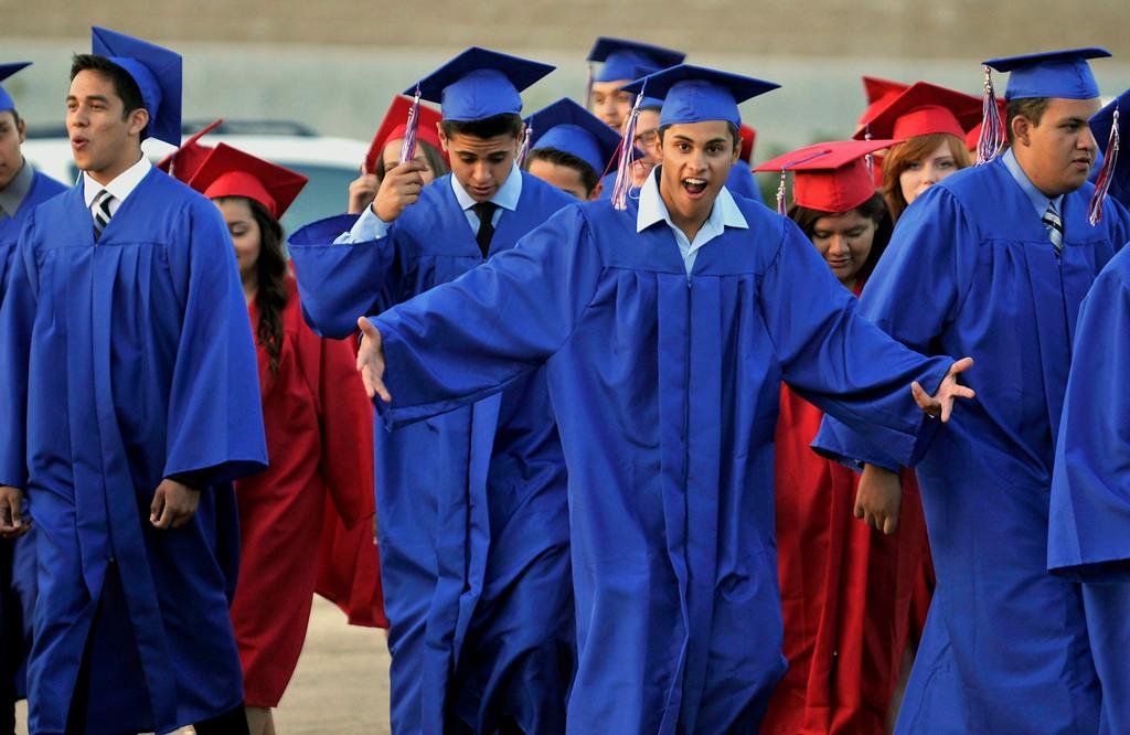 . Graduates enter the stadium.  Los Altos High School\'s 53 Commencement Ceremonies held in the Patrick Mauch Memorial Stadium, Tuesday, May 21, 2013.  (Correspondent photo/Mike Mullen)