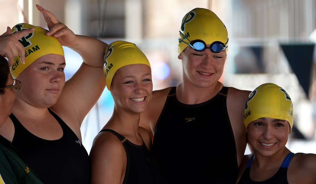 . Notre Dame Academy girls pose for a photograph during the Division 4 CIF Southern Section Swimming Championships in the Riverside Aquatics Complex at Riverside City College in Riverside, Calif., on Friday, May 16, 2014.  (Keith Birmingham/Pasadena Star-News)