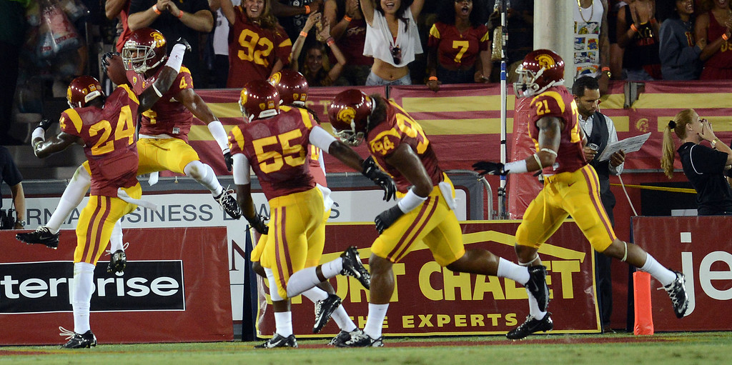 . USC\'s Torin Harris #4 celebrates after he intercepted a pass in the end zone intended for Washington State\'s Kristoff Williams #18 in the 1st quarter at the Los Angeles Memorial Coliseum  Saturday, September 7, 2013.  (Photo by Hans Gutknecht/Los Angeles Daily News)
