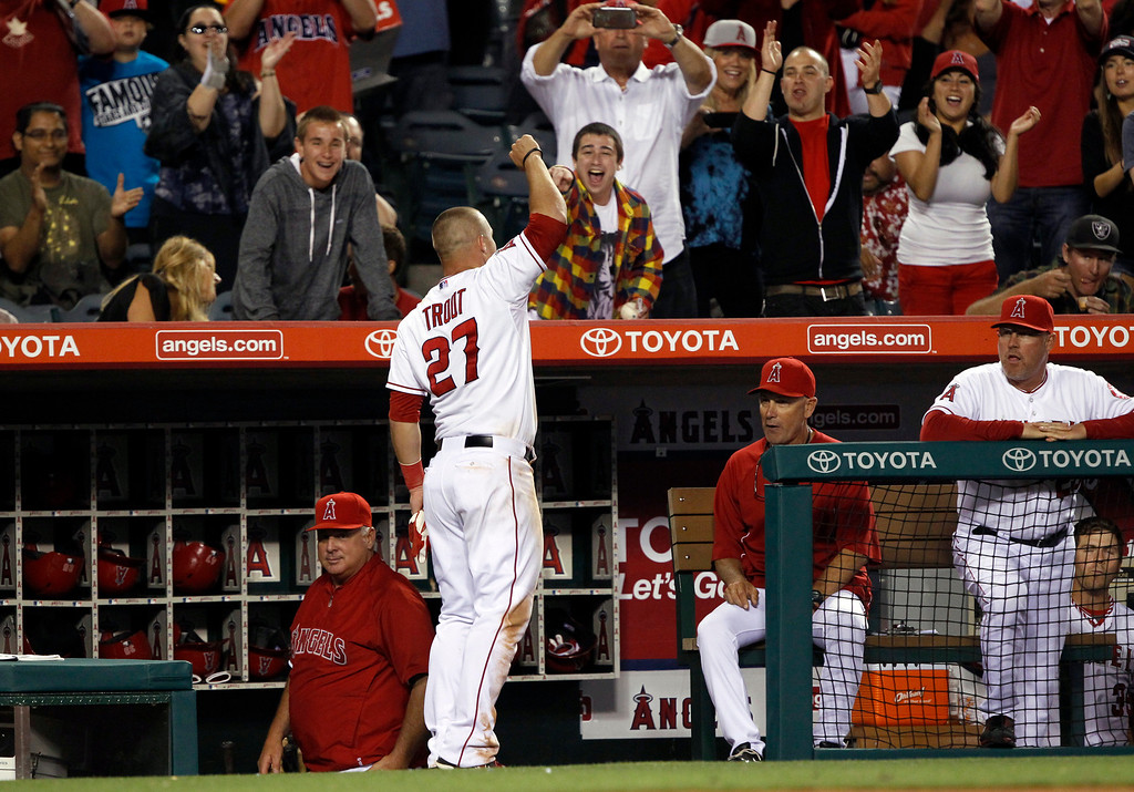 . Los Angeles Angels\' Mike Trout (27) acknowledges the crowd after he hits a solo home run in the eighth inning, hitting for the cycle against the Seattle Mariners during a baseball game Tuesday, May 21, 2013 in Anaheim.  The Angels won the game 12-0.   (AP Photo/Alex Gallardo)