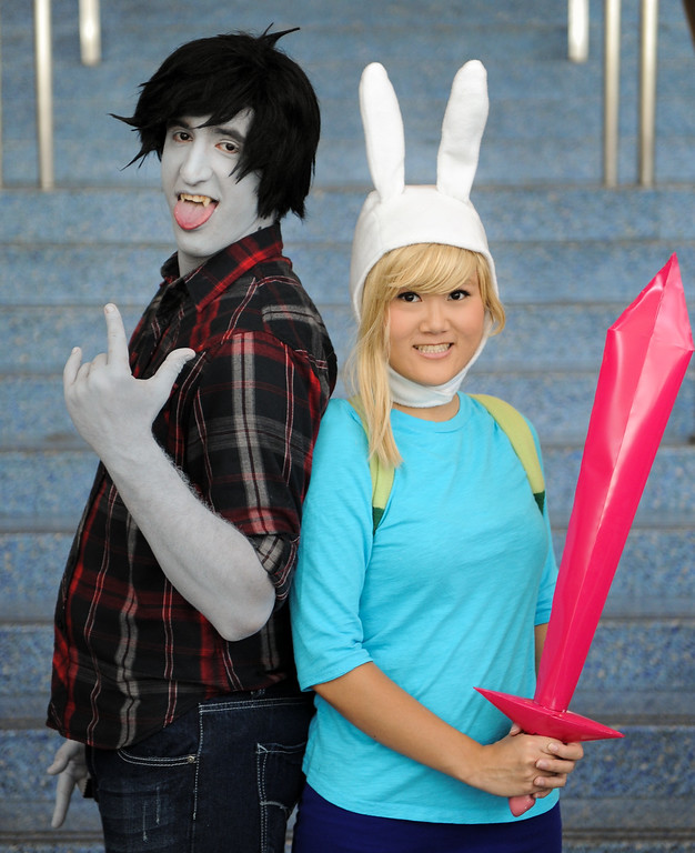 . Frankie Martinez, dressed as Marshal Lee, and Ann Tani, dressed as Fiona, at the Anime Expo at the L.A. Convention Center, Saturday, July 6, 2013. (Michael Owen Baker/L.A. Daily News)