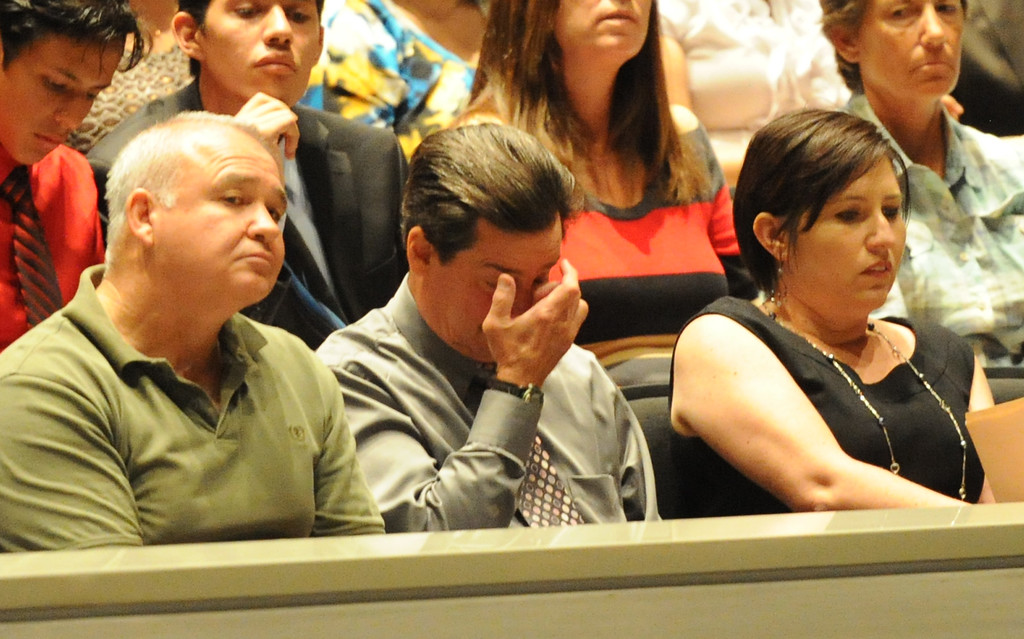 . Former cross-country coach James O\'Brien wipes his eye as Joshua Tran (not pictured) speaks about his former coach as over 200 people crowded the Arcadia Unified School District Performing Arts Center as a show of support for fired Arcadia High School cross-country coach James O\'Brien during a Arcadia Unified School District Board of Education meeting on Tuesday, July 23, 2013 in Arcadia, Calif. O\'Brien, led the team to two time state and national championships.