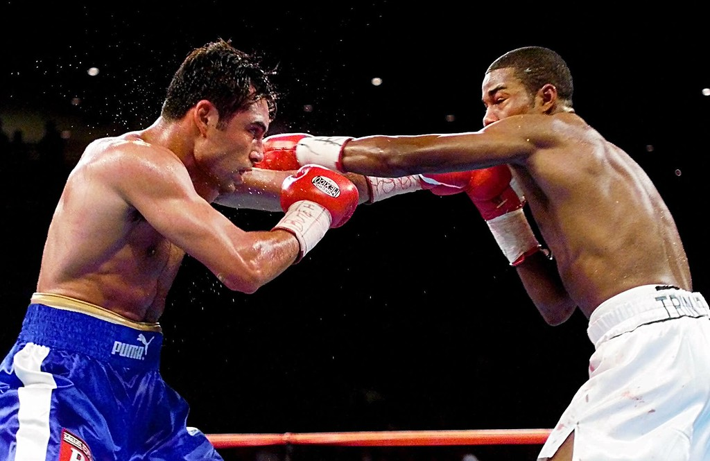 . Oscar De La Hoya, left, exchanges blows with Felix Trinidad during the fifth round of their WBC/IBF Welterweight Championship bout at the Mandalay Bay Events Center in Las Vegas Saturday, Sept. 18, 1999. Trinidad won the bout by way of decision after 12 rounds. (AP Photo/Eric Draper)
