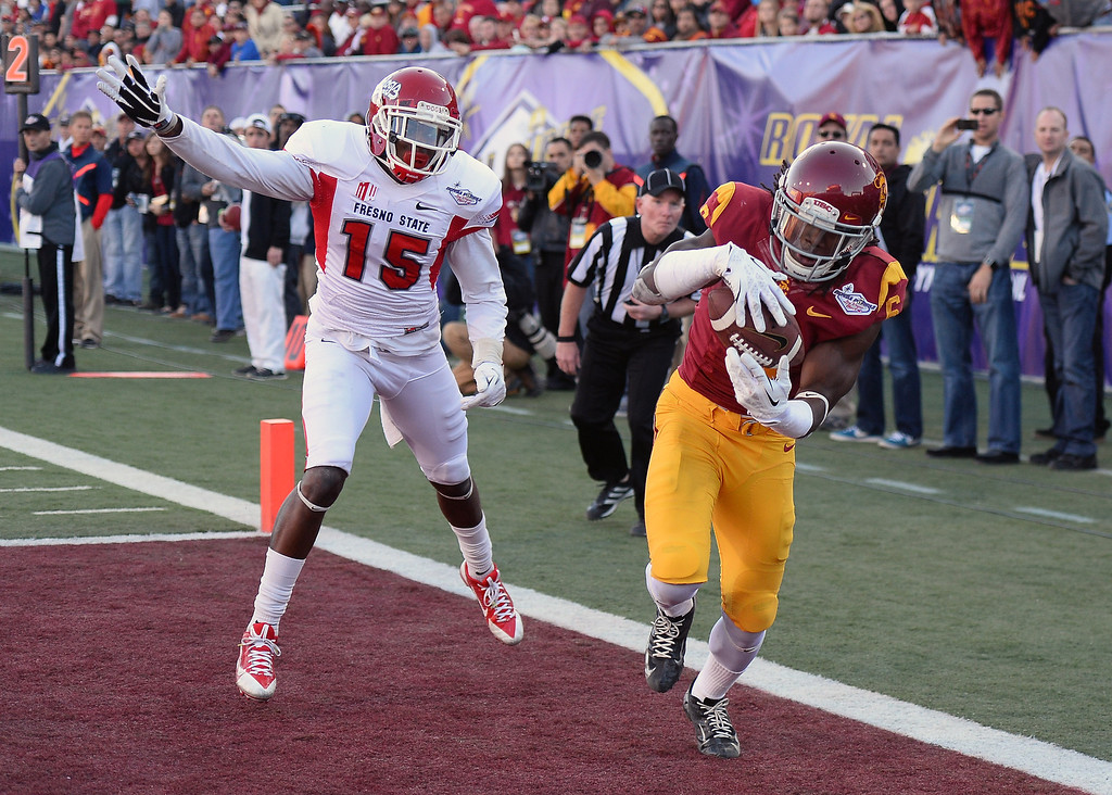 . LAS VEGAS, NV - DECEMBER 21:  Josh Shaw #6 of the USC Trojans intercepts a pass in the end zone that was intended for Davante Adams #15 of the Fresno State Bulldogs during the Royal Purple Las Vegas Bowl at Sam Boyd Stadium on December 21, 2013 in Las Vegas, Nevada. USC won 45-20.  (Photo by Ethan Miller/Getty Images)