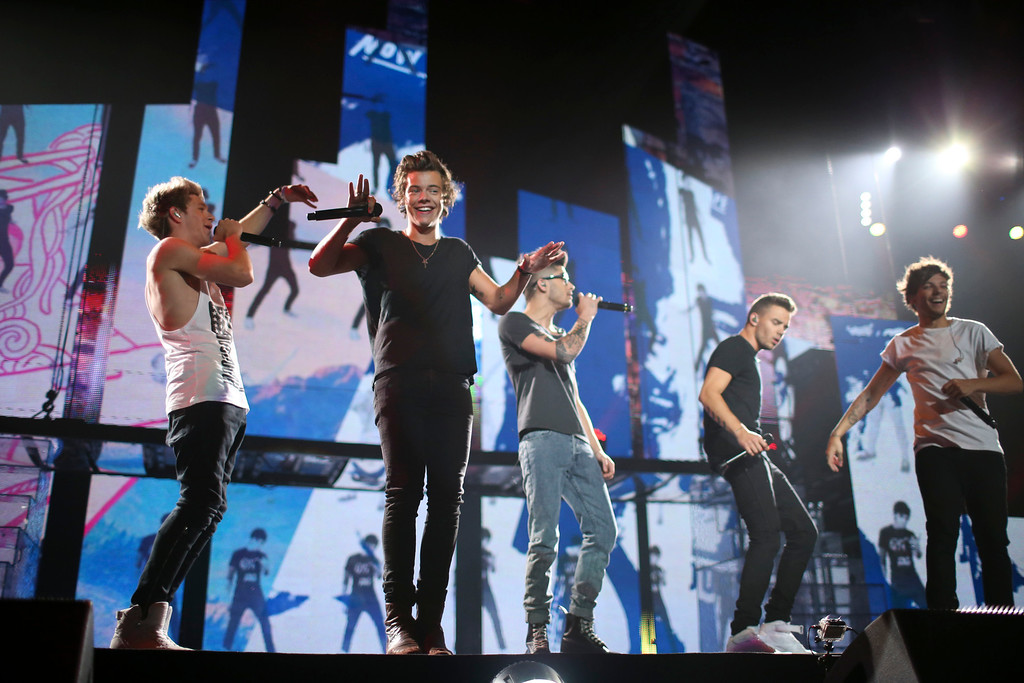 . British boy-band One Direction performs at the Target Center in Minneapolis Thursday night, July 18, 2013.  (AP Photo/Star Tribune, Jeff Wheeler)