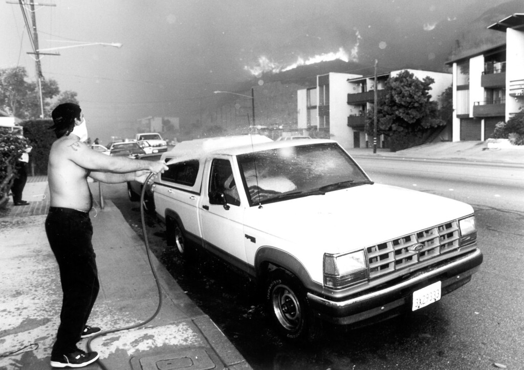. A man hoses down a truck.  (11/2/93) Los Angeles Daily News file photo