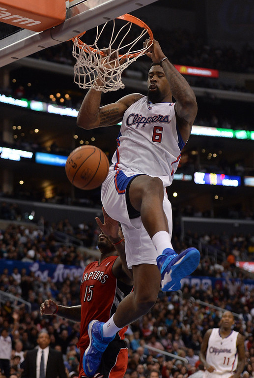 . The Clippers� DeAndre Jordan #6 alley oop dunks as the Raptors� Amir Johnson #15 looks on during their game at the Staples Center in Los Angeles Friday, February 7, 2014. (Photo by Hans Gutknecht/Los Angeles Daily News)