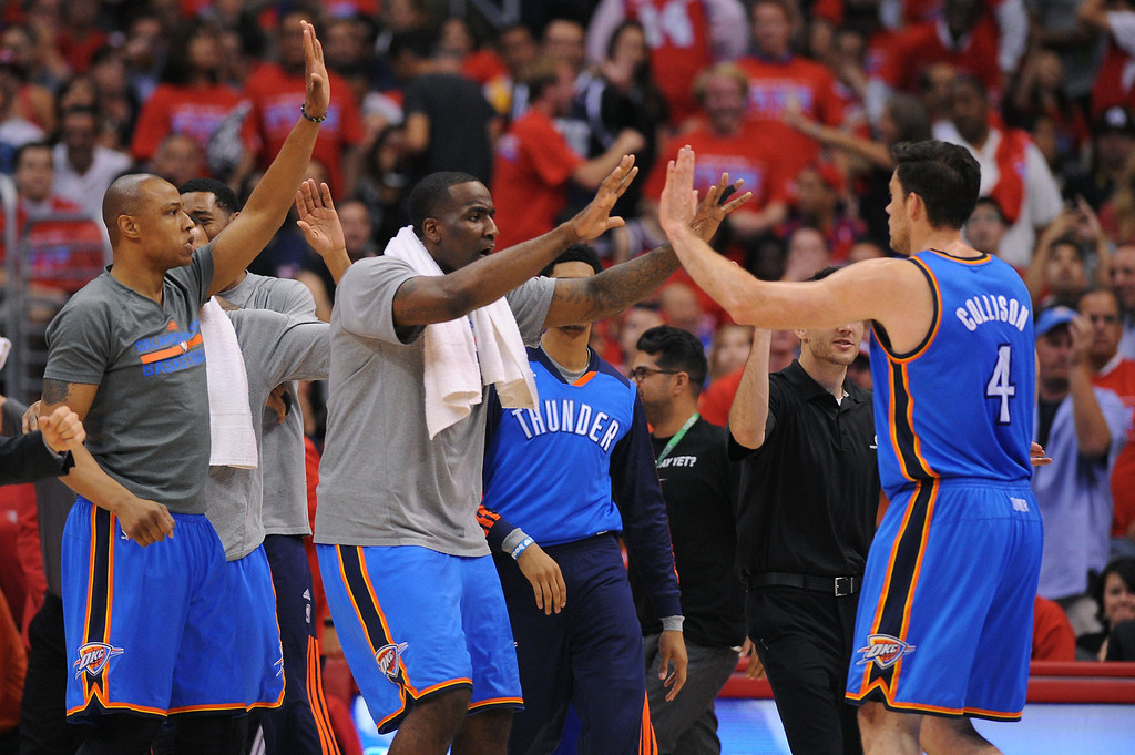 . The Thunder celebrate at three-pointer by Nick Collison, right, during a Clippers timeout, Thursday, May 15, 2014, at Staples Center. (Photo by Michael Owen Baker/Los Angeles Daily News)