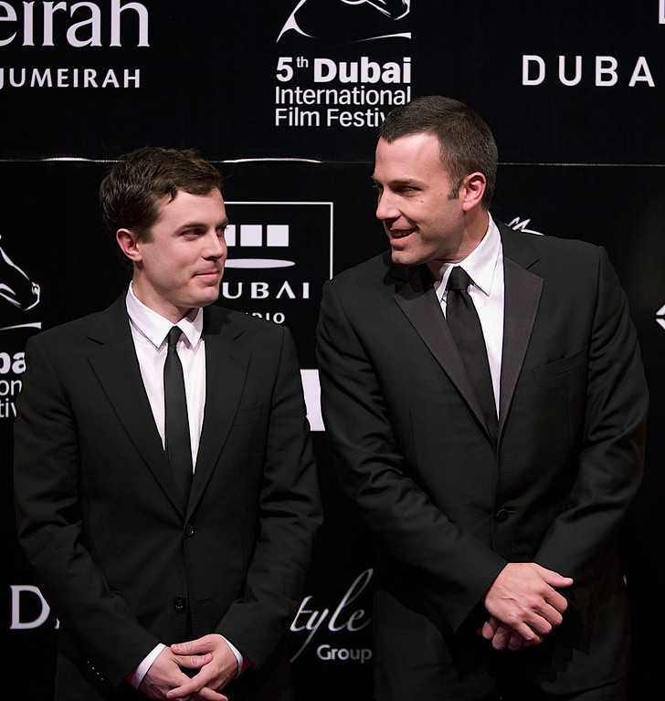 . Actor Ben Affleck (R) and his brother Casey Affleck (L) arrive on the red carpet at the opening of the 5th Dubai International Film Festival In Dubai,United Arab Emirates.Thursday,Dec.11, 2008.(AP Photo/Nousha Salimi)