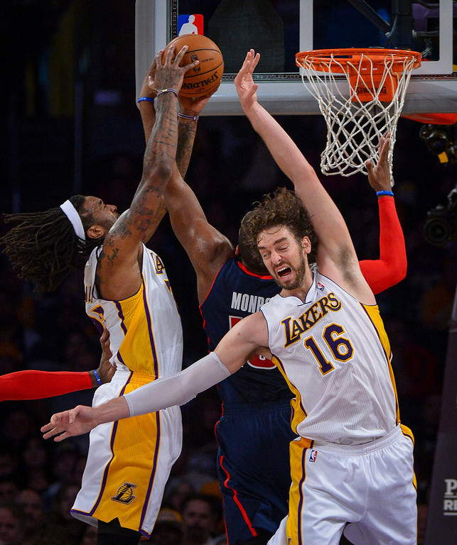 . Lakers� Pau Gasol and Jordan Hill defend against a shot by Detroit�s Greg Monroe during first half action at Staples Center Sunday, November 17, 2013.  ( Photo by David Crane/Los Angeles Daily News )