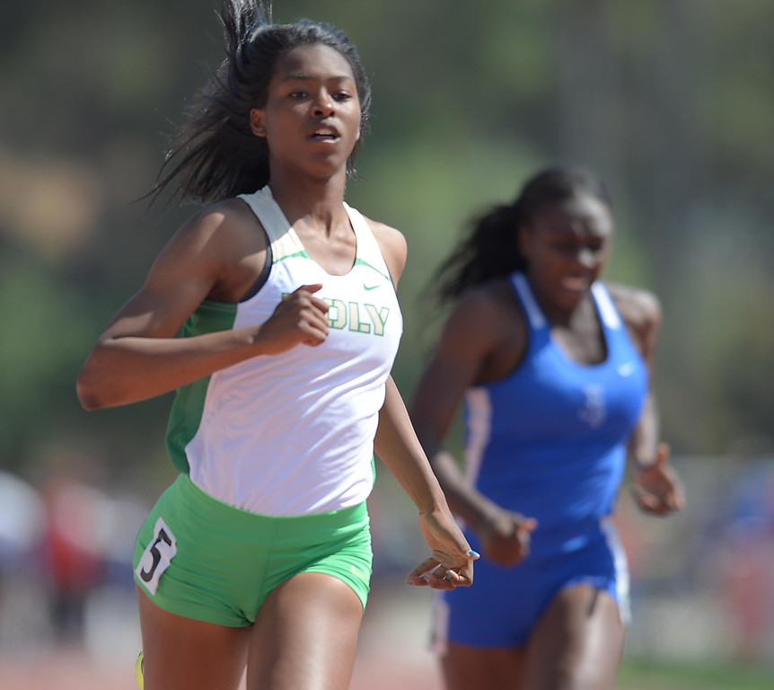 . Long Beach Poly\'s Arianna Washington adds to her medal collection by winning the 100 meter Division 1 race of the CIF Southern Section Track and Field Championships Saturday at Mt. SAC. Jordan\'s La Troya Franklin, right, took second. 20130518 Photo by Steve McCrank / Staff Photographer