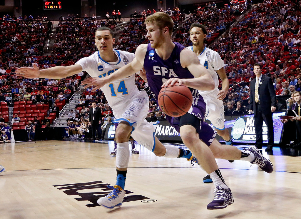 . Stephen F. Austin\'s Thomas Walkup drives the baeline against UCLA guard Zach LaVine in the first half of a third round game in the NCAA college basketball tournament Sunday, March 23, 2014, in San Diego.  (AP Photo/Gregory Bull)