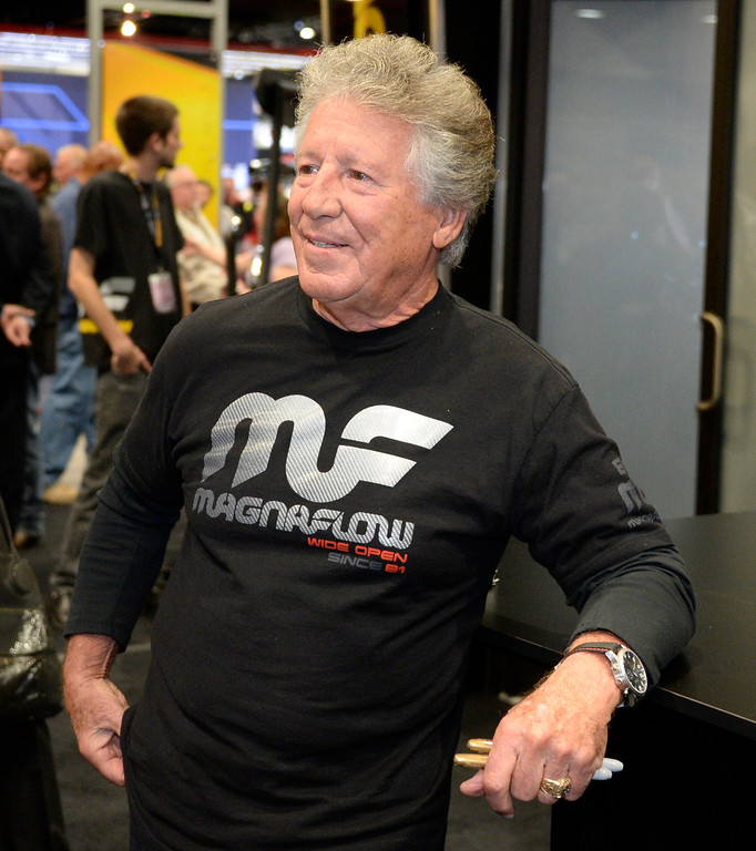 . Nov 6,2013 Las Vegas NV. USA. Racing legend  Mario Andretti signs autographs at the Magnaflow booth during the second day of the 2013 SEMA auto show.