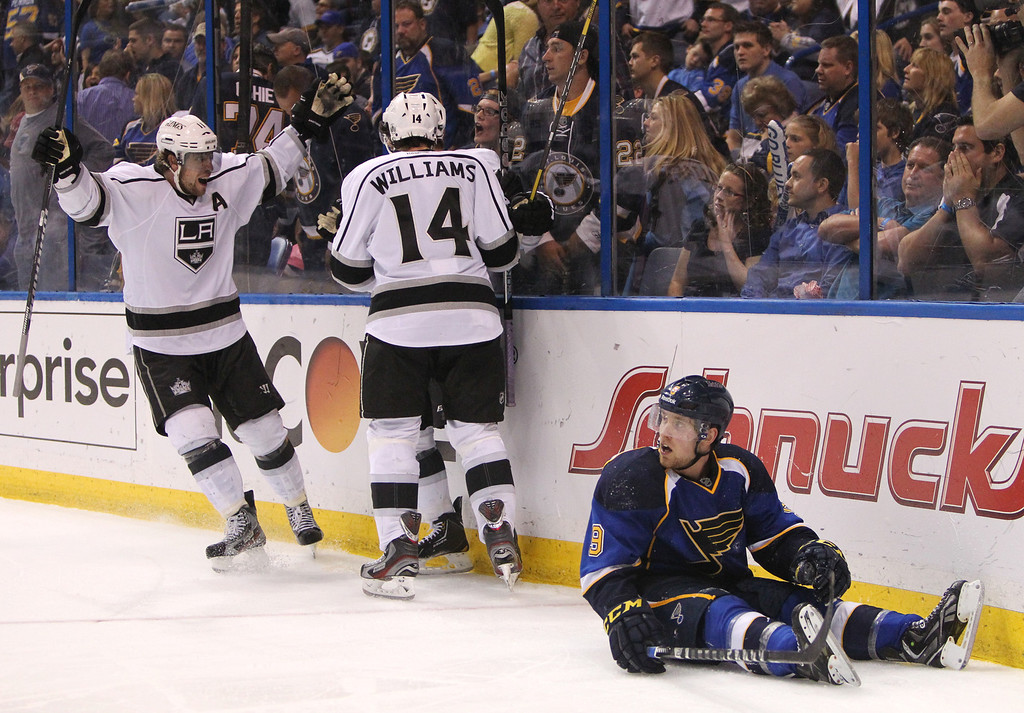 . Los Angeles center Anze Kopitar (left) joins teammates Justin Williams and Slava Voynov (obscured) in celebrating Voynov\'s game-winning goal in overtime during Game 5 of the Western Conference quarterfinals between the St. Louis Blues and the Los Angeles Kings on Wednesday, May 8, 2013, at the Scottrade Center in St. Louis.  At right is Blues left wing Jaden Schwartz. (AP Photo/St. Louis Post-Dispatch, Chris Lee)