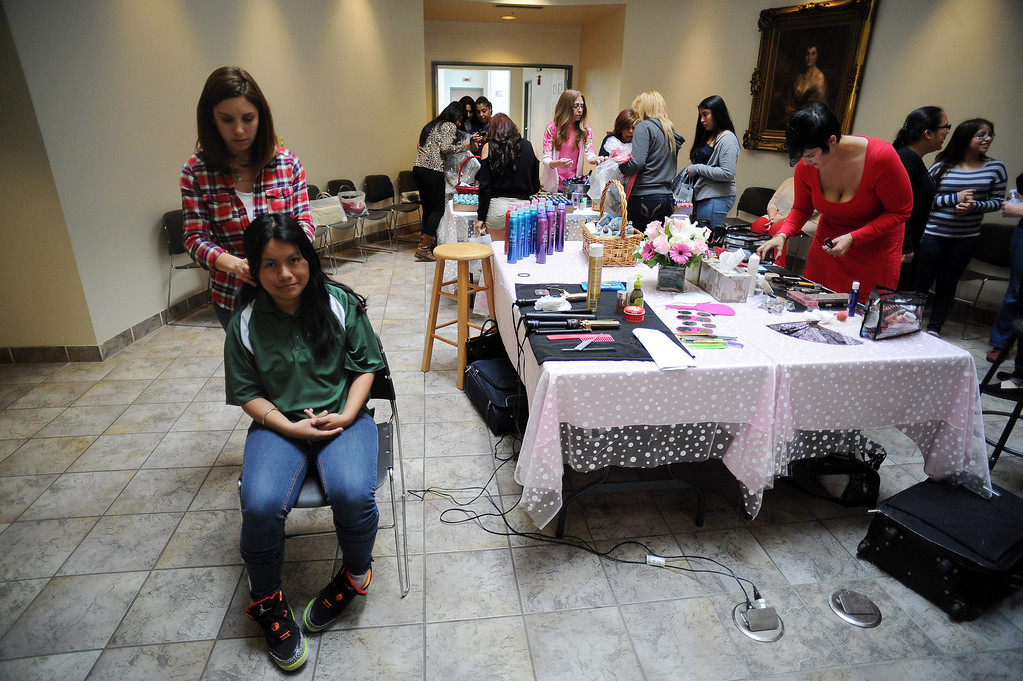 . Hairdresser Marina Mlgliaccio gives Marilu Rendon, 18, a styling at the Assistance League of Los Angeles in Hollywood Thursday, March 6, 2014. Operation School Bell Prom Day program outfitted 56 low-income and homeless high school girls from 17 LAUSD schools with dresses, shoes and other accessories so they can attend their proms.(Photo by Hans Gutknecht/Los Angeles Daily News)