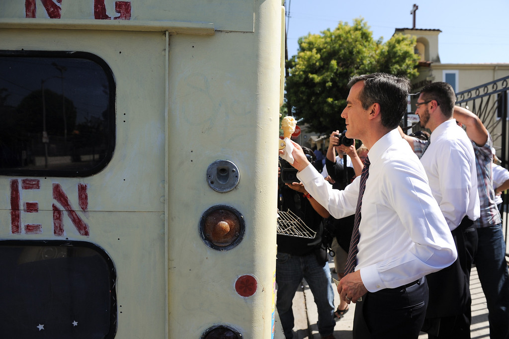 . Mayoral candidate Eric Garcetti buys a scoop of vanilla ice cream from an ice cream truck on a warm day in front of Dolores Mission Church in East Los Angeles during his Whistle Stop Tour of LA, Monday, May 20, 2013. (Michael Owen Baker/Staff Photographer)