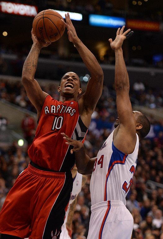 . The Raptors� DeMar DeRozan #10 shoots as the Clippers� Willie Green #34 defends during their game at the Staples Center in Los Angeles Friday, February 7, 2014. (Photo by Hans Gutknecht/Los Angeles Daily News)