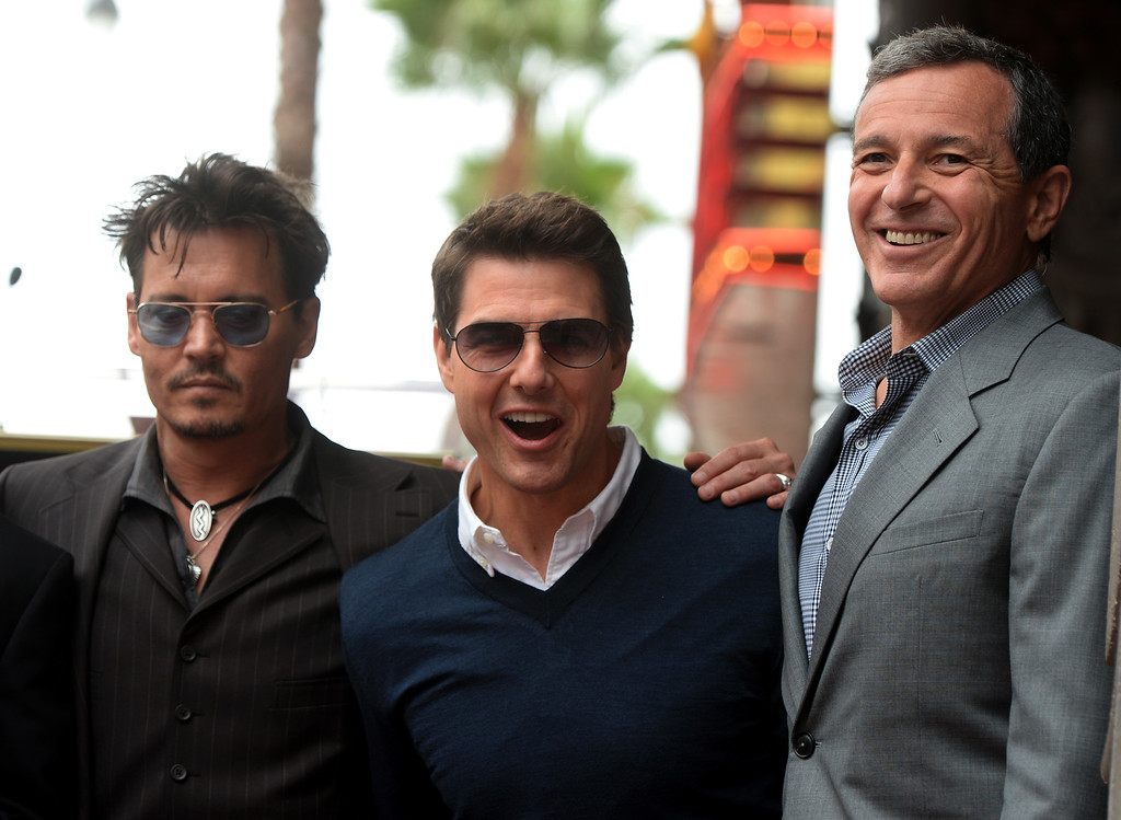 . US actors Johnny Depp (L), Tom Cruise (C) and Disney Chairman and CEO Bob Iger (R) attend the star ceremony for US producer Jerry Bruckheimer (unseen) on the Hollywood Walk of Fame, in Hollywood, California, USA, 24 June 2013. Bruckheimer received the 2,501st star on the Hollywood Walk of Fame.  EPA/MICHAEL NELSON