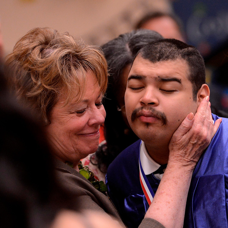 . Judy Penman, left, congratulates graduate Hipolito Lamas, right, during Commencement Ceremonies at Carl And Dora Anderson School in San Bernardino May 21, 2013.  Seventeen developmentally disabled students graduated from the school.  GABRIEL LUIS ACOSTA/STAFF PHOTOGRAPHER.