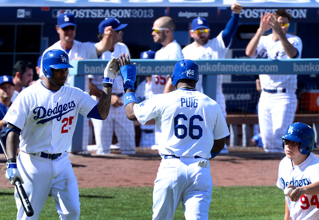. Los Angeles Dodgers\' Yasiel Puig scores a run in the second inning of game 5 of the NLCS at Dodger Stadium Wednesday, October 16, 2013. (Photo by Sarah Reingewirtz/Los Angeles Daily News)