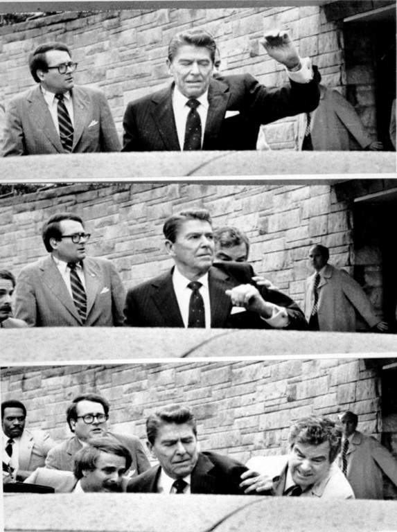 . President Ronald Reagan waves and then looks up before Secret Service Agents shove him into the Presidential limousine after being shot outside a Washington hotel in this sequence of March 30, 1981 file photos.  Reagan died on Saturday, June 5, 2004 at 93.  (AP Photos/Ron Edmonds)