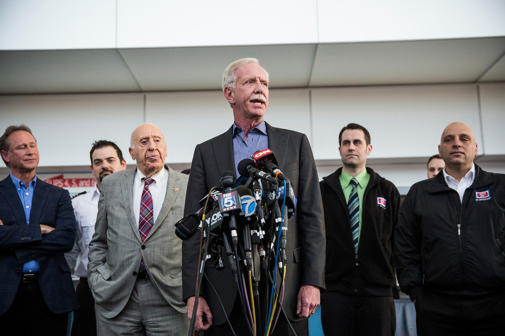""". NEW YORK, NY - JANUARY 15:  Chesley \""""Sully\"""" Sullenberger (C), a retired airline captain famous for landing a commercial jet on the Hudson River, celebrates the five year anniversary of \""""The Miracle on the Hudson\"""" at a press conference and photo opportunity on January 15, 2014 in New York City. On January 15, 2009, Sullenberger took off from La Guardia airport while piloting US Airways Flight 1549 with 150 passengers and five crew members. The plane hit a goose shortly after take off, forcing Sullenberger to land the plane in the Hudson River; no one was killed.  (Photo by Andrew Burton/Getty Images)"""