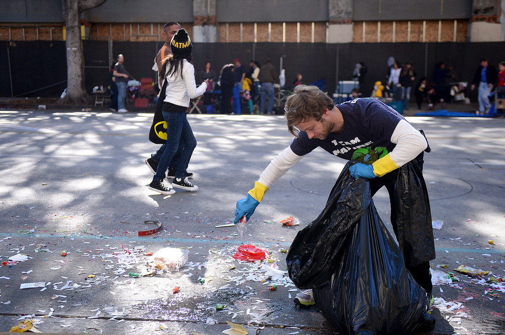 . Benjamin Kay, of Team Marine from Santa Monica High School, picks up plastic bottles on Colorado Boulevard after the 125th Rose Parade in Pasadena, CA January 1, 2014. (Photo by Sarah Reingewirtz/Pasadena Star-News)