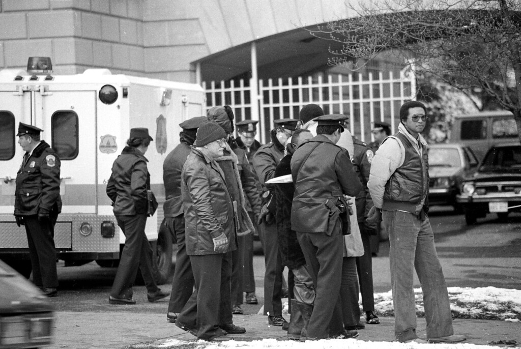 . A handcuffed Arthur Ashe is led away from the South African Embassy by police in Washington, D.C., Friday, Jan. 12, 1985.  The retired tennis champion and 46 others were arrested near the embassy during their demonstration against apartheid policies of the South African government.  (AP Photo/Lana Harris)