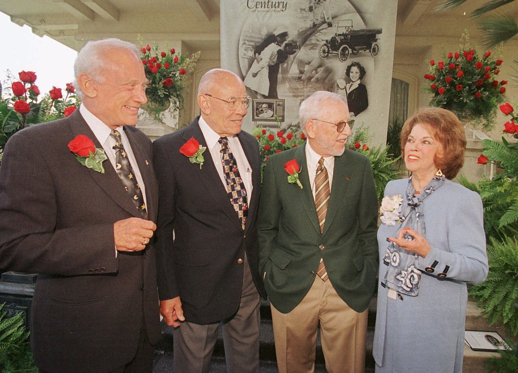""". The four Grand Marshals of the 1999 Tournament of Roses Parade, from left: astronaut Buzz Aldrin, Ray Bartlett, lifelong friend of baseball legend Jackie Robinson, film producer and documentarian David Wolper and actress Shirley Temple Black are introduced Thursday, Sept 17, 1998, at the Tournament House in Pasadena, Calif. Tournament of Roses President Dick Ratliff chose the four 20th century legends because they epitomize the parade theme \""""Echoes of the Century.\""""  (AP Photo/Nick Ut)"""