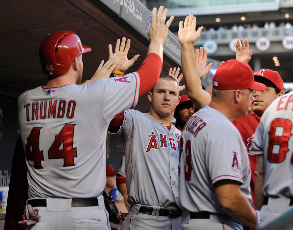 . MINNEAPOLIS, MN - SEPTEMBER 9: Mark Trumbo #44 of the Los Angeles Angels of Anaheim celebrates scoring a run against the Minnesota Twins during the fourth inning of the game on September 9, 2013 at Target Field in Minneapolis, Minnesota. (Photo by Hannah Foslien/Getty Images)