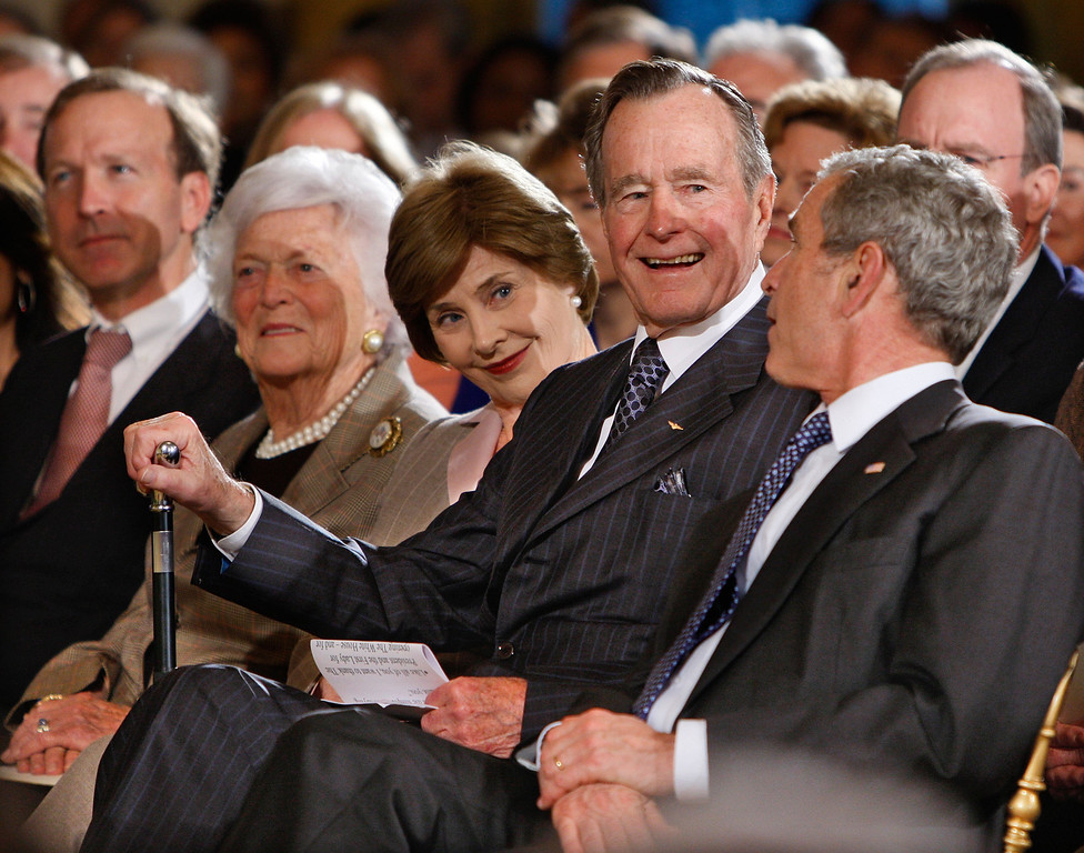 . President George W. Bush, right, sits with, from left, his brother Neal Bush; his mother, former first lady Barbara Bush; his wife first lady Laura Bush; and father, former President George H.W. Bush, as they take part in a reception in honor of the Points of Light Institute, Wednesday, Jan. 7, 2009, in the East Room at the White House in Washington. (AP Photo/Ron Edmonds)