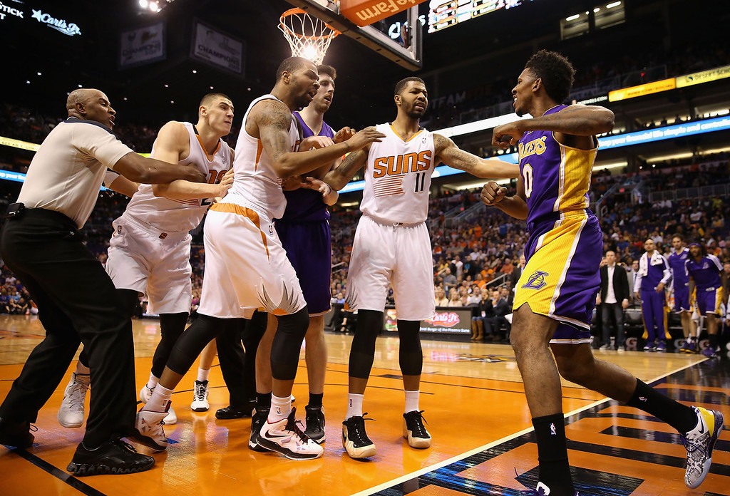 . Marcus Morris #15 and Markieff Morris #11 of the Phoenix Suns push Nick Young #0 of the Los Angeles Lakers after he reacted to Alex Len #21 (second from left) for a flagrant foul during the first half of the NBA game at US Airways Center on January 15, 2014 in Phoenix, Arizona.    (Photo by Christian Petersen/Getty Images)