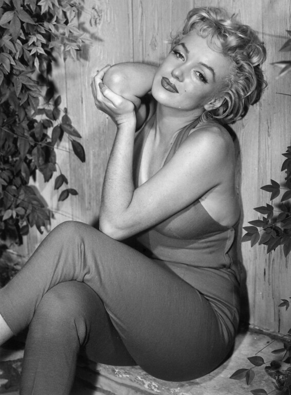 . 1954:  Marilyn Monroe (1926 - 1962) relaxes in Palm Springs.  (Photo by Baron/Getty Images)