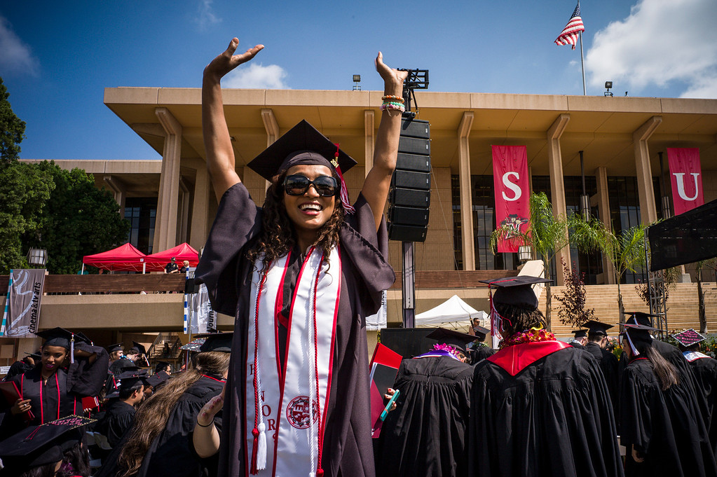 . Edda Zabala, a CSUN graduate in Television and Film arts waves to family and friends during graduation ceremonies at Cal State Northridge Monday, May 19, 2014.  ( Photo by David Crane/Los Angeles Daily News )