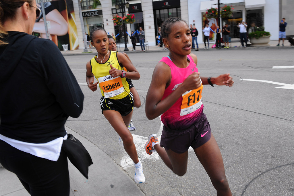 . Women\'s elite division winner Amane Gobena, right, leads ladies at mile 17 in Beverly Hills in the Los Angeles Marathon, Sunday, March 9, 2014. (Photo by Michael Owen Baker/L.A. Daily News)