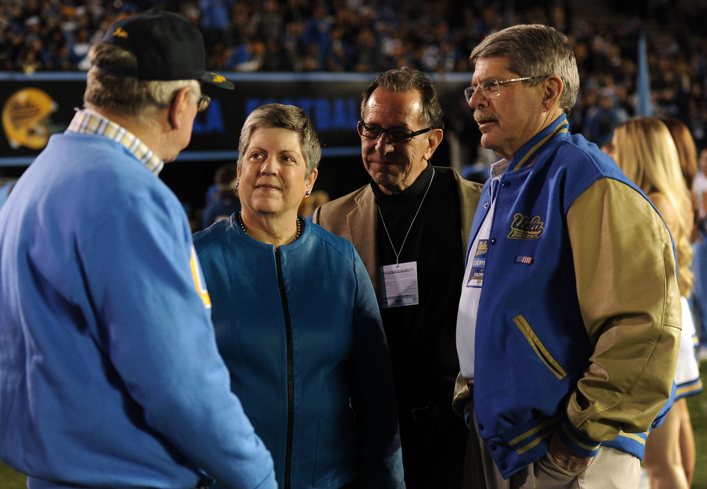 . Former United States Secretary of Homeland Security and current President of the University of California system, Janet Napolitano ,second from left, along with Los Angeles County Board of Supervisors member, Zev Yaroslavsky, right, talk with UCLA alumni prior to their college football game against California in the Rose Bowl in Pasadena, Calif., on Saturday, Oct. 12, 2013.   (Keith Birmingham Pasadena Star-News)