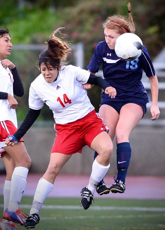 . Sierra Vista\'s Maria Hernandez (14) and Camarillo\'s Sirena Seymour (19) go for a header as Camarillo defeats Sierra Vista 3-1 in a quarterfinal game at Sierra Vista High School in Baldwin Park, February 28, 2014. (Photo by Sarah Reingewirtz/Pasadena Star-News)
