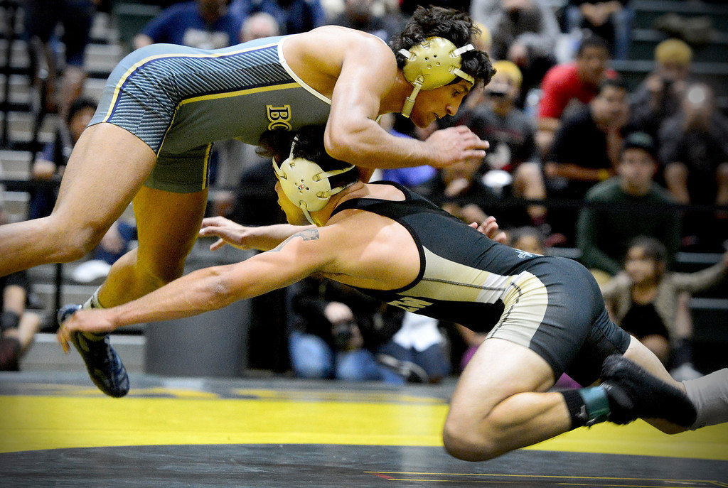 . St. John Bosco\'s Anthony Valencia, a nationally ranked wrestler, defeats Northview\'s Bryan Salinas, top California wrestler, during the semifinals of the CIF-SS Division 2 wrestling finals at South Hills High School in West Covina Saturday night, February 8, 2014. Northview claimed championship after defeating Servite 42-30. (Photo by Sarah Reingewirtz/Pasadena Star-News)