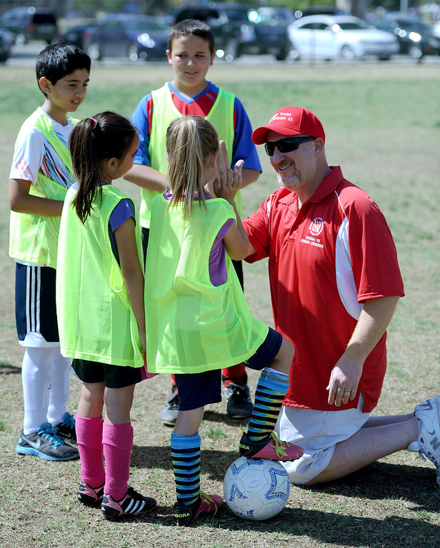 """. Hershey Weisman talks with children before they play in a game. In honor of the AYSO\'s 50th anniversary as the nation�s most active and open youth soccer organization, kids at Balboa Park in Encino will join efforts around the country Saturday--over 500,000 players,125,000 volunteers,100 community-based events and a national soccer festival--to set a world record for the \""""largest pickup game on Earth.\"""" Encino, CA. 5/3/2014(Photo by John McCoy / Los Angeles Daily News)"""