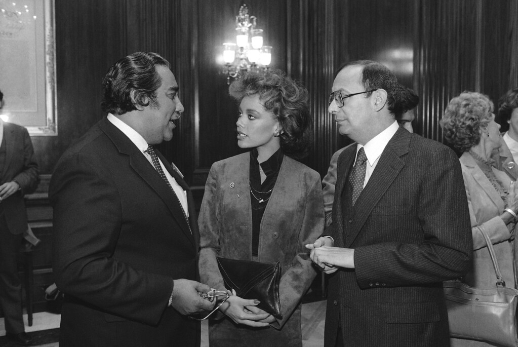 . Miss America Vanessa Williams is flanked by Rep. Charles Rangel, D-N.Y., left, and Sen. Alfonse D?Amato, R-N.Y., during a reception on Capitol Hill in Washington, Monday, Oct. 17, 1983. (AP Photo/Edmonds)