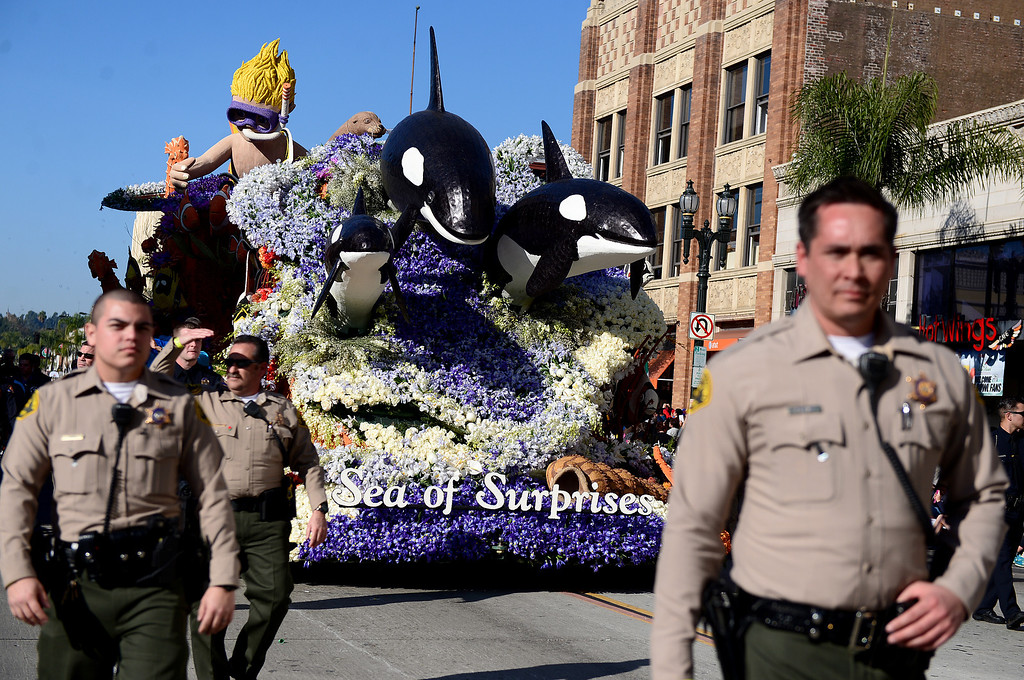 """. Seaworld Parks \""""Sea of Surprises\"""" float heads down Colorado Boulevard with heavy security during the 125th Rose Parade in Pasadena, CA January 1, 2014. (Photo by Sarah Reingewirtz/Pasadena Star-News)"""