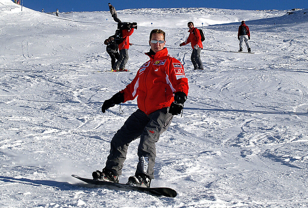 . (dpa) - German formula one driver Michael Schumacher snowboards in the ski resort Madonna di Campiglio, Italy, Thursday 13 January 2005. Schumacher learned just recently how to snowboard. Traditionally the Ferrari team goes skiing with its drivers under the motto \'Wrooom\' one week at the beginning of the new year. Photo by: Oliver Multhaup/picture-alliance/dpa/AP Images
