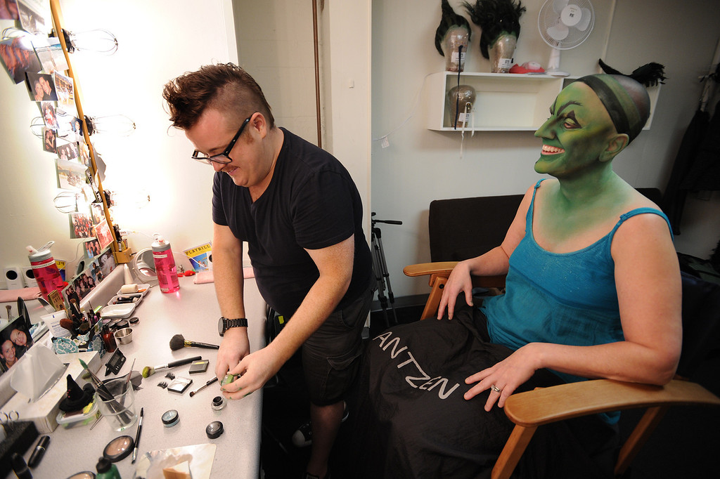 . Makeup is almost complete, only eyelashes, lipstick and a wig are next. Jacquelyn Piro Donovan is transformed into the Wicked Witch by makeup artist Michael King. The Wizard of Oz is being staged at the Pantages Theatre in Hollywood, CA. 9/25/2013. photo by (John McCoy/Los Angeles Daily News)