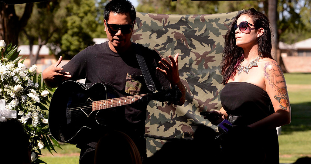 """. A musical selection was played by a friend during a tribute for Charles \""""Mask\""""  Lewis Jr. at Mountain View Cemetery in San Bernardino, CA on Saturday September 7, 2013.  (Photo by Gabriel Luis Acosta/San Bernardino Sun)"""